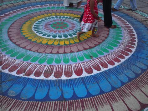 Beautiful sidewalk art at a temple