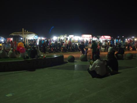 The Marina Beach boardwalk lined with food and drinks for sale
