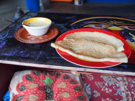 I'm really enjoying the food all over India, but here in Tamil Nadu I'm starting to get a lot of coconut-based foods, which I love!  This is a breakfast - 2 dosas and a coconut curry chutney.