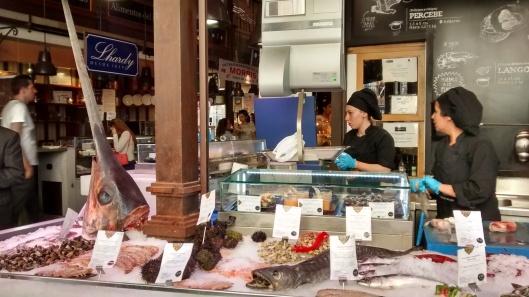 Checking out the seafood counter at Mercado de San Miguel