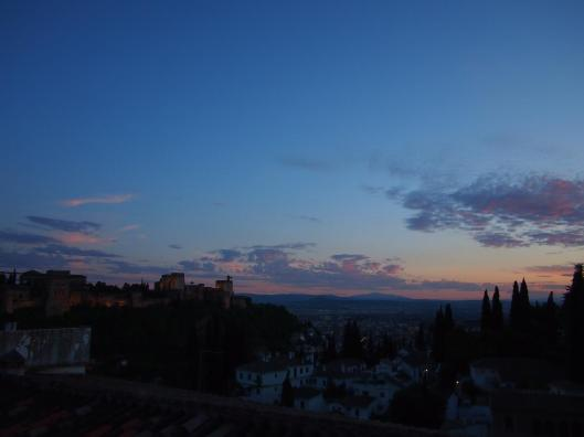 Sunset over Granada with the Alhambra across the way.